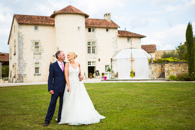 Bride and Groom portrait. outside chateau in France