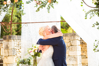 bride and groom during ceremony hugging