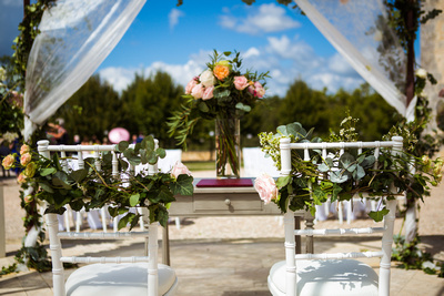 Roses intertwined on chiavari wedding chairs
