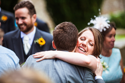 Wedding in Oxfordshire - bride hugging guest
