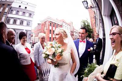 Photo of bride and groom walking
