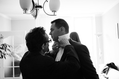 Groom getting ready,  buttonhole