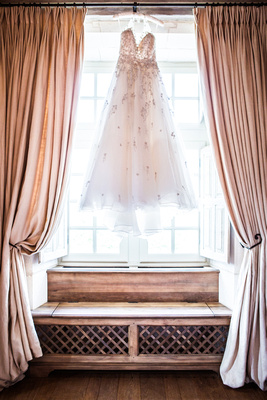 Wedding dress hanging in window, Chateaux wedding in France