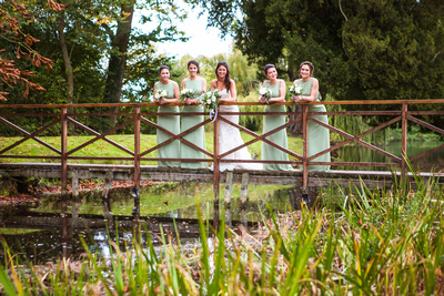 wedding at Ardington House bride and bridesmaids on bridge