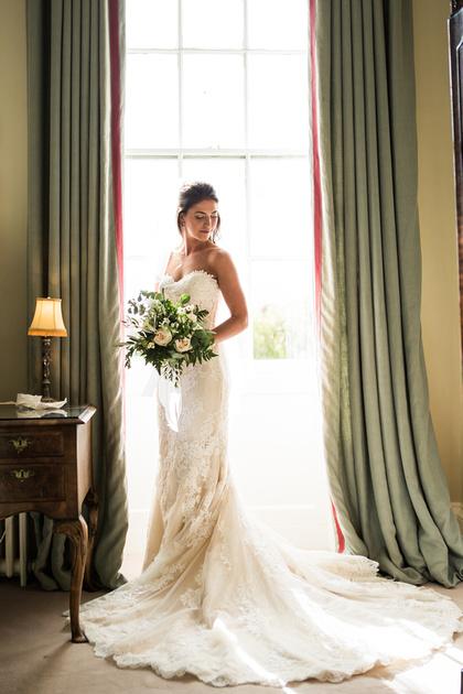 Bride in window looking over shoulder