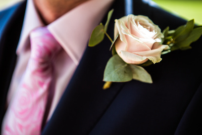 Close up of grooms corsage / button hole