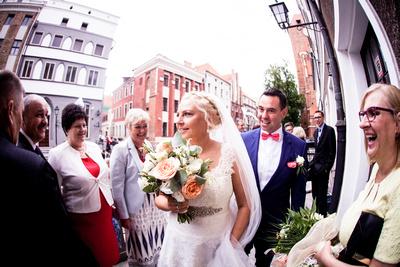 Photo of bride and groom walking