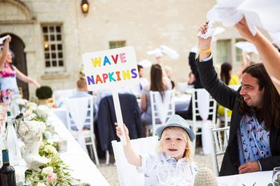 Wedding reception, boy holding sign