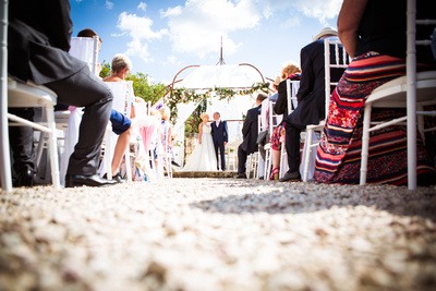 Bride and groom during ceremony outside, documentary wedding photography