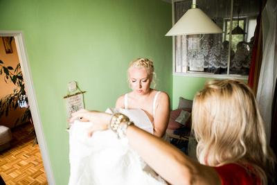 Bride getting ready. getting dress on